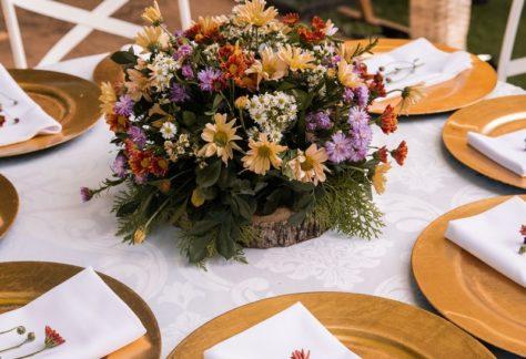 green and purple flower bouquet on table